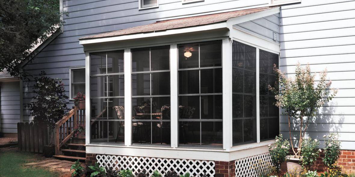 image shows sunroom built by Porch Conversion of Charlotte with EZE Breeze Windows